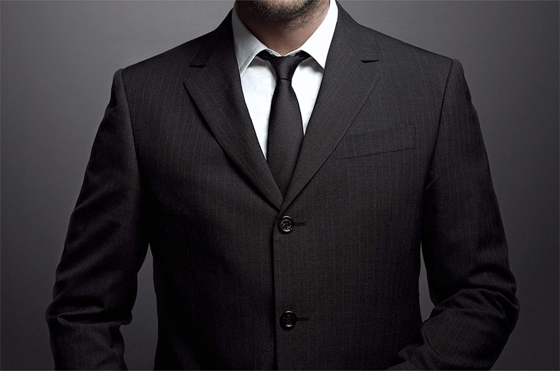 This Swanky Suit Lets You Show Off Your Wealth and Get a Free Vacation